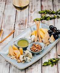 plate-with-different-cheeses-and-grapes-