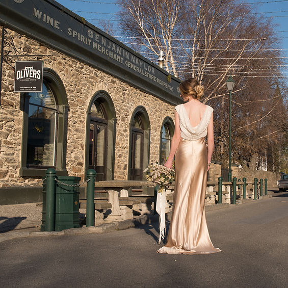 Style Lily by Margaret Wray bridal outside Olivers Restaurant and Bar in Clyde, Central Otago