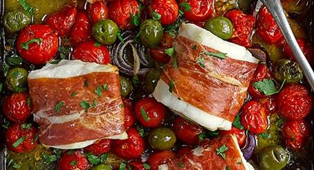 Cod, cherry tomato, parma ham and olive tray bake Serves 6