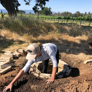 Building our Biodynamic barrel compost pit with local stone and my working hands!