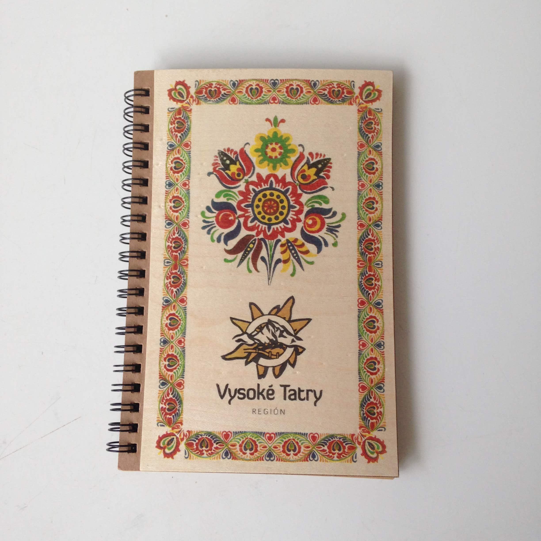 Veneer fronted notebook