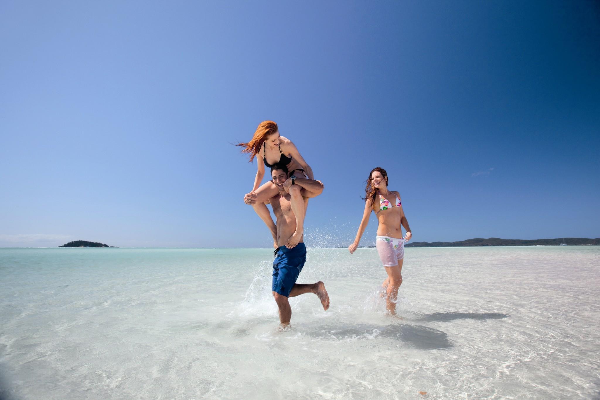 People splashing on beach one 106252-688 A