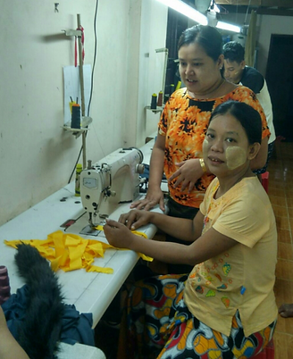 Ma Phyo Ei Ei Htwe working in a sewing factory