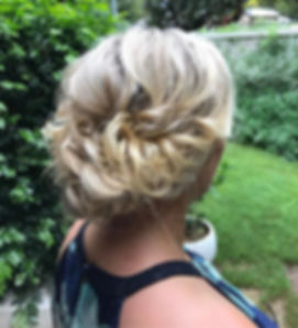 textured messy bun wedding hair