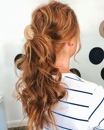 low curled pony wedding hair