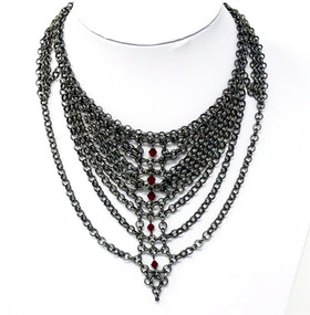 Neo-goth design with embedded beads and chain draping