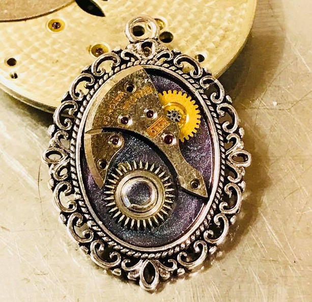 Purple enamelled steampunk pendant