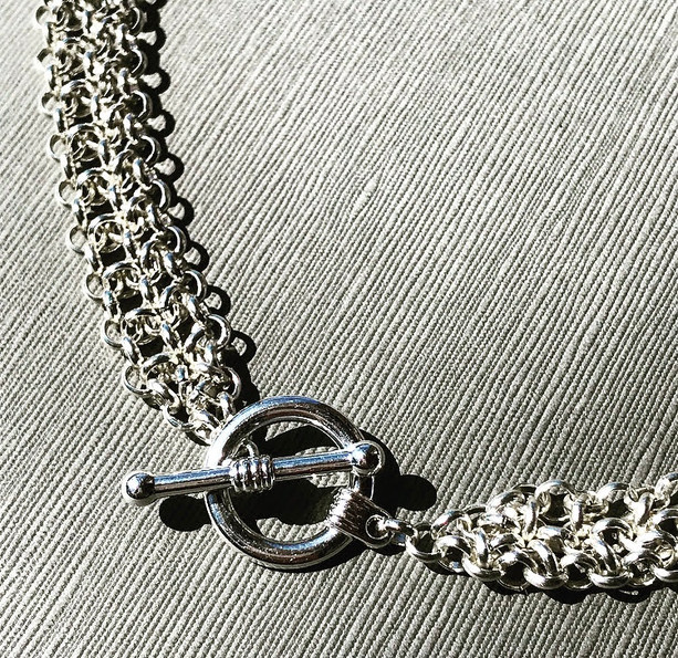 Minimalist chainmail statement necklace with toggle clasp design feature