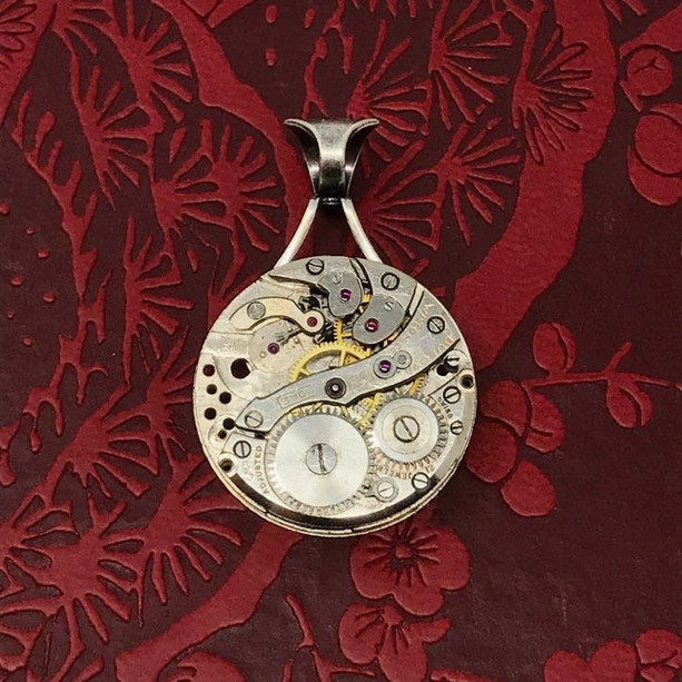 Elegant clockwork steampunk pendant