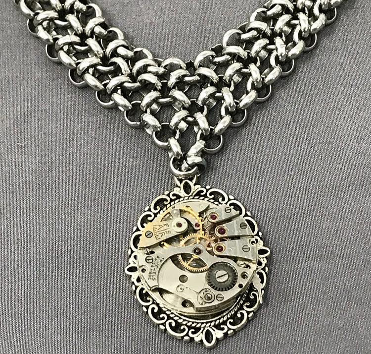 Steel mail necklace with watch movement pendant