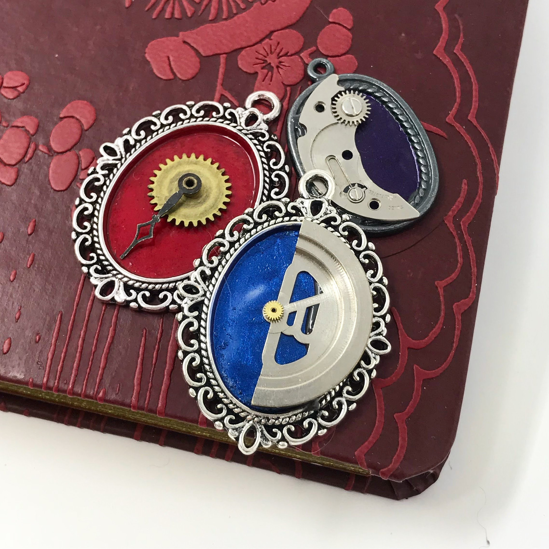 Multicoloured enamel steampunk pendants