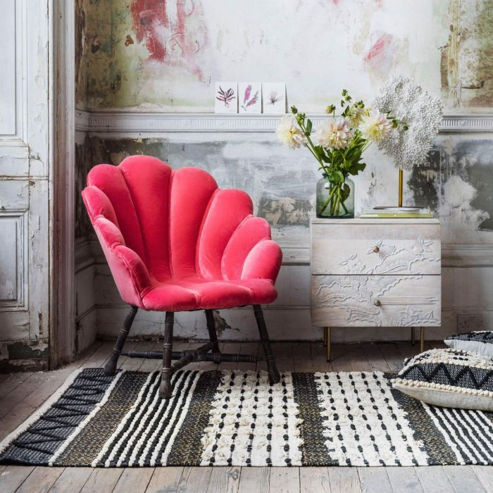 Coral pink clam shell style chair