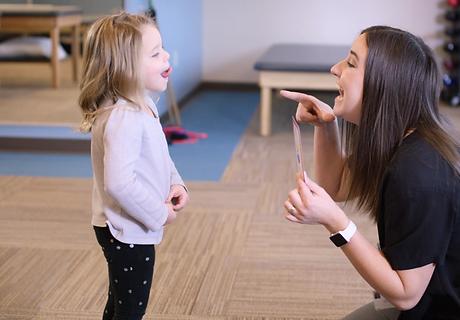 Speech Therapists teaching girl patient