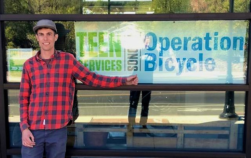 Adrian Palenchar at entrace to new Operation Bicycle shop!