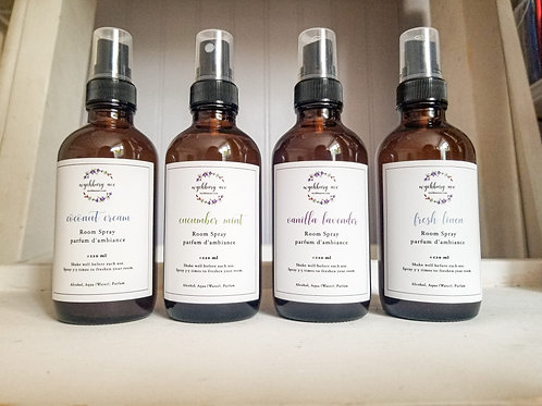 Bottles of coconut cream, vanilla lavender, fresh linen, and cucumber mint room spray lined up together.