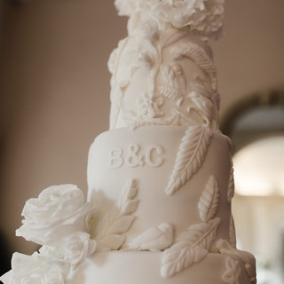 SEVEN TIERS OF SCULPTED BAS-RELIEF CAKE