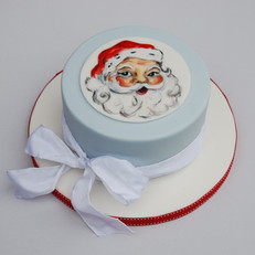 Father Christmas cakeHandpainted traditional fruit Christmas cake
