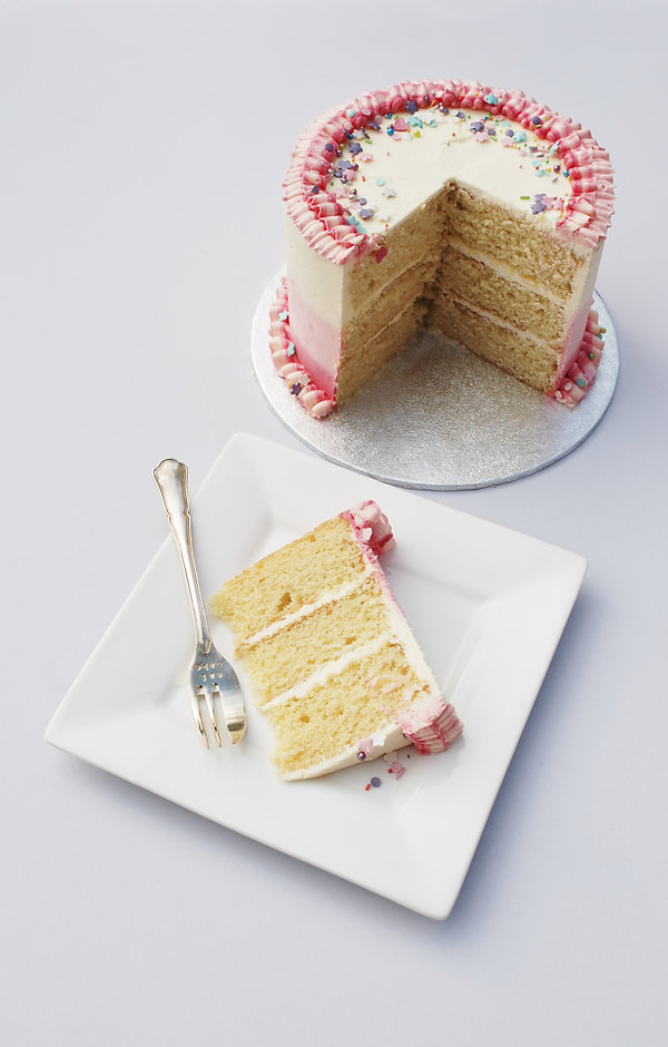 Simple three layer cake with buttercream ruffles