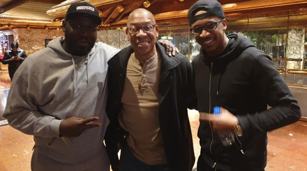 Michael With UK Comedians (Left KG Tha Comedian and (right) Travis Jay