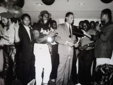 (Left to right) Craig Fraizer, Jerry Winn, David Williams, Jay Anthony Brown, Michael Williams, Robin Harris, Keenen Ivory Wayans, Robert Townsend