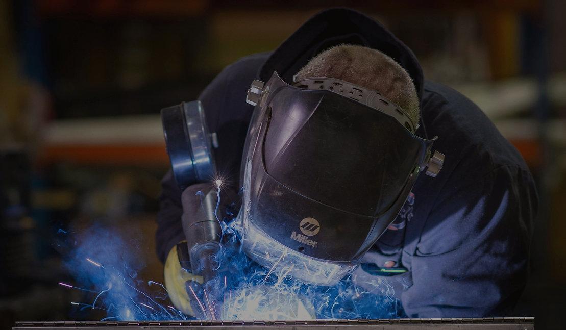 Martak employee welding