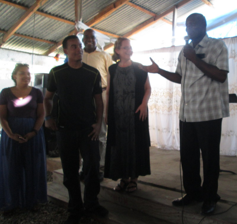 Lex presents AJay and his host family from the Parish of All Saints at church in Thozin