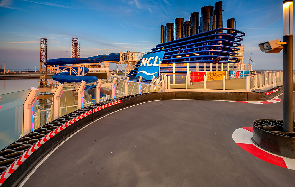 Norwegian Bliss features a two level electric car competitive race track.