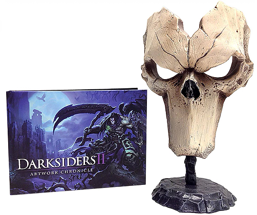 Scale replica of Joe Madureira's Mask of Death on a stand and an art book that chronicles the scenery and characters in Darksiders II.