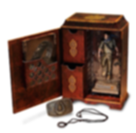 Arabic-styled traveling medicine chest-inspired box with figurine, iconic brushed metal belt buckle, and replica wearable ring with engraved game symbols.