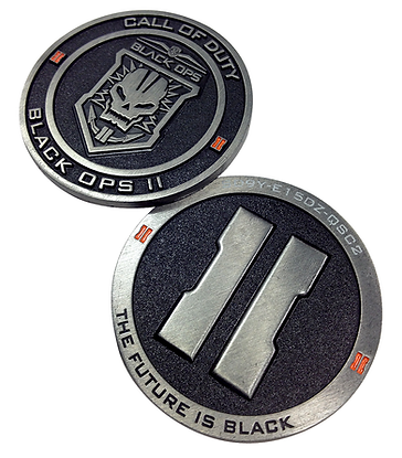 Extreme close-up of front of two Call of Duty challenge coins showing embossing & enamel fill details. Back of coin features unique variable code etched in edge.