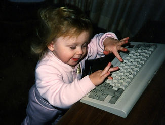 Stacy Typing as a Baby