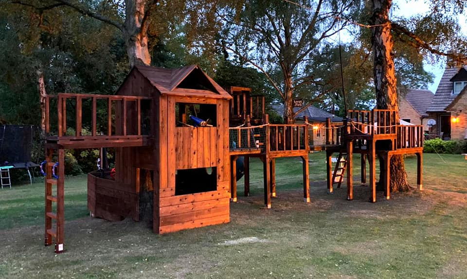 Large treehouse with bridges, tube slide, ship shaped playhouse and zip wire