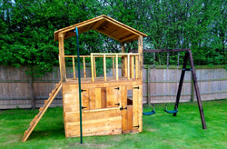Double decker playhouse with internal ladder and serving hatch