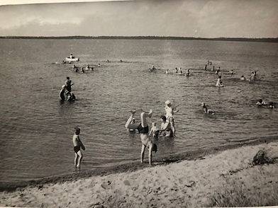 Campers swimming in Star Lake