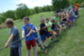 Campers playing tug-of-war