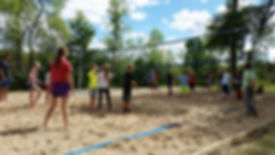 Campers playing volleyball