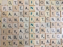 Scrabble. 'Infinite Possibilities' a Radio 4 story by Anita Sullivan. Woman in space suit.