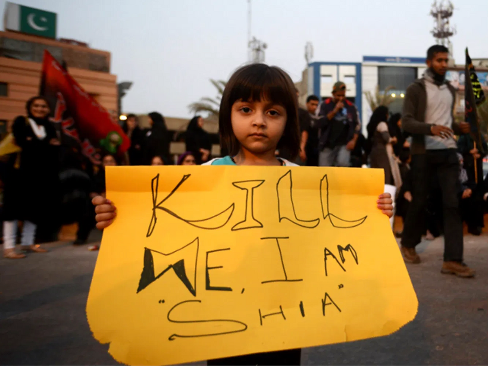 A Pakistani Shia Muslim girl holds a placard during a protest against sectarian violence in Karachi, Pakistan in a file photo. Photo: AFP