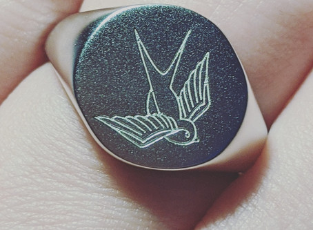 Modern silver signet rings.