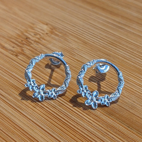 Silver flower open circle studs