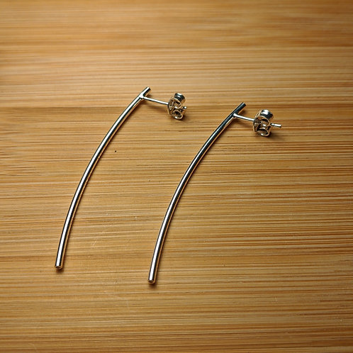 Silver curved spike long stud earrings
