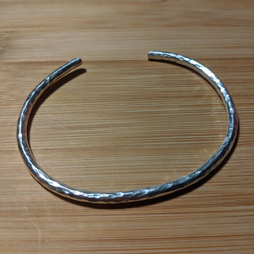 Oval silver hammered bangle