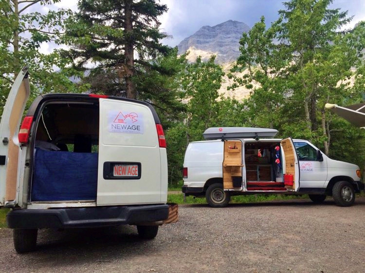 Two camper van conversions parked with free Kananaskis Conservation Pass
