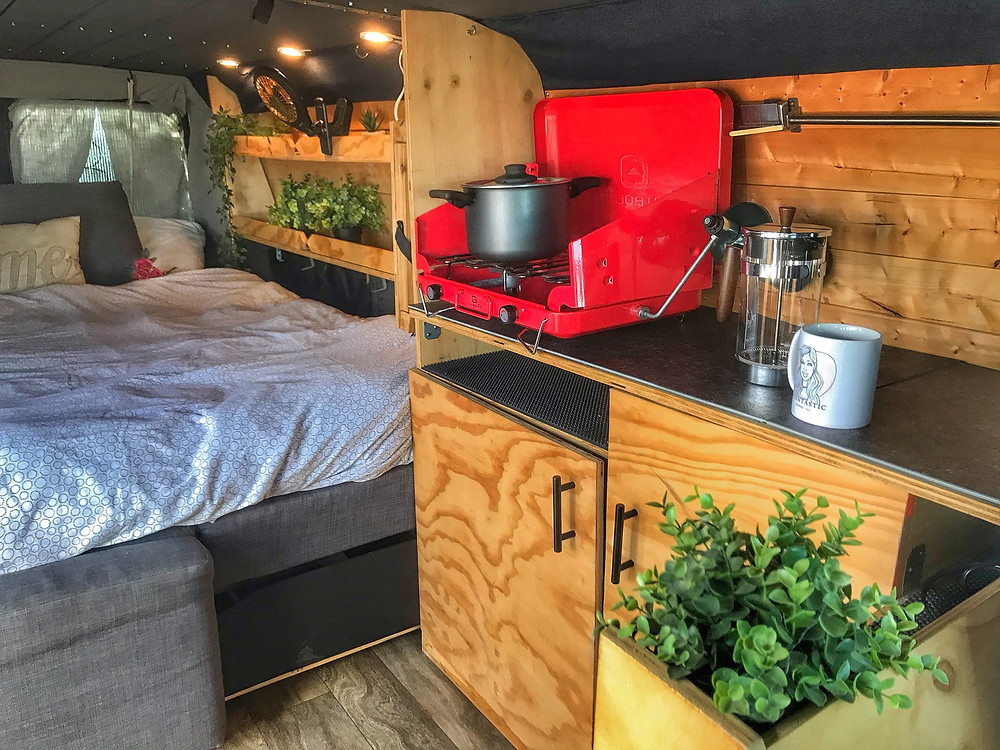 the campervan kitchen set up for the traveling hermit