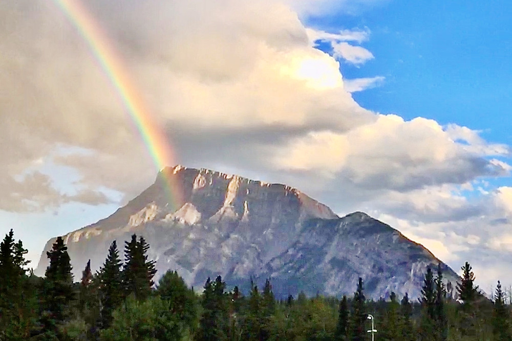 Rainbow over the mountain showing the magic and romance in the Canadian Rockies