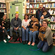 Happy puppies and owners at puppy class