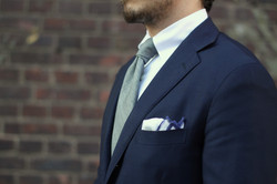 Gray-BergBerg-wool-tie-with-blue-Caruso-suit