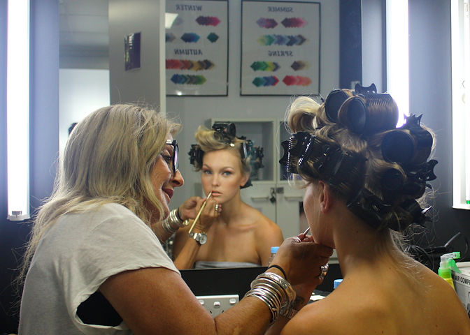 Trainer completing Makeup for a Photoshoot