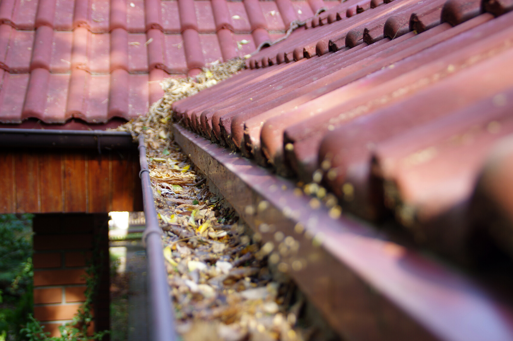 Clogged gutters can cause roof damage