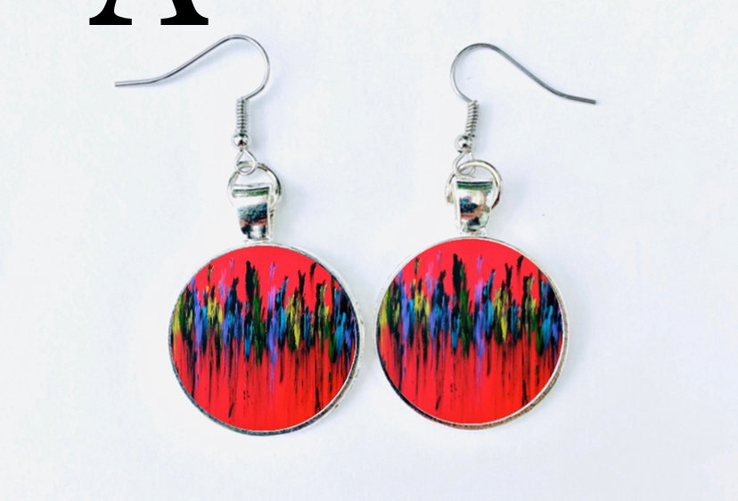 Earrings by Kamelyta Noor
